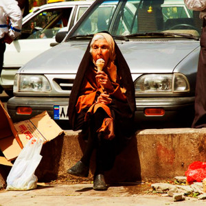 Lady in Tehran eating ice cream by kamshots licensed under CC BY 2.0 (edited).